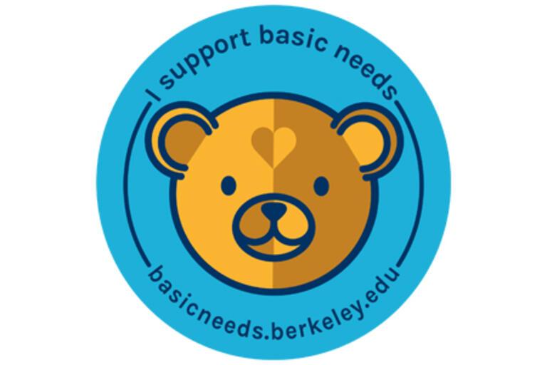 basic needs center logo with orange bear