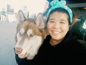 Rose Tsang smiling with dog